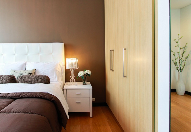 master bedroom with a bedside lamp adding mood
