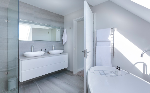 a spacious modern bathroom with quality accessories